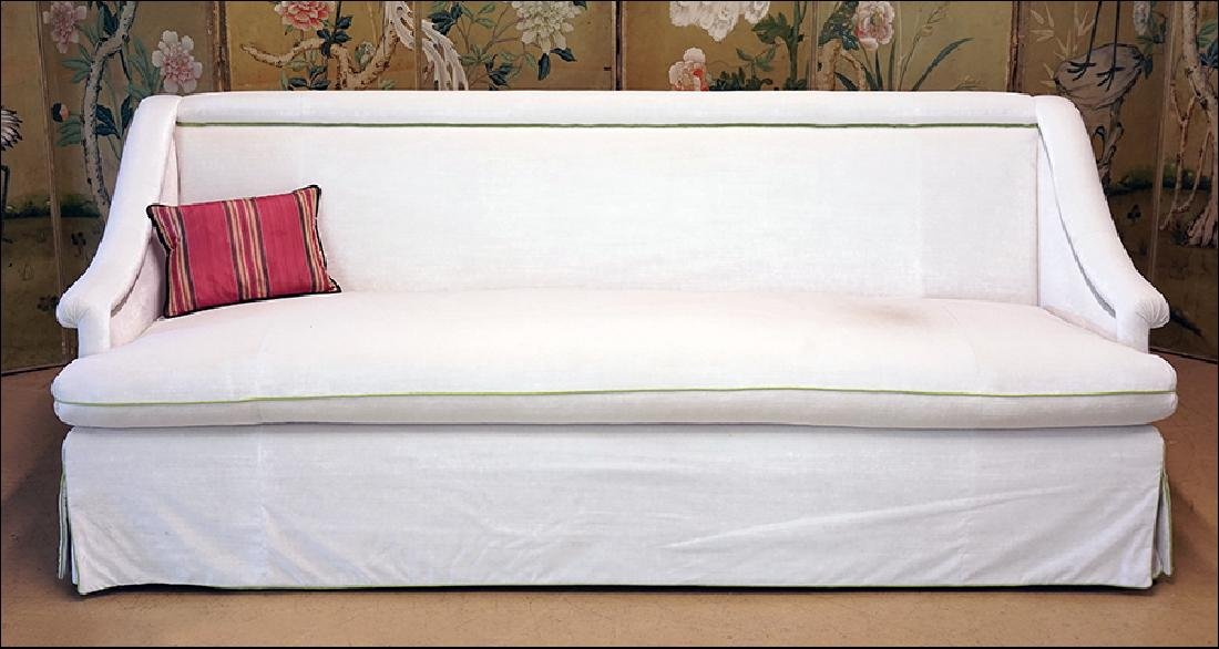 A White Silk Velvet Sofa.