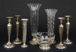 A Set of Four Weighted Sterling Silver Candlesticks