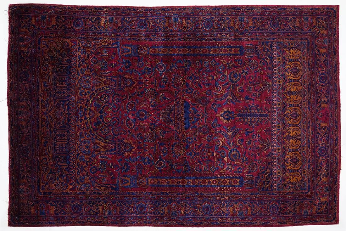 An Antique Silk Kashan Rug.