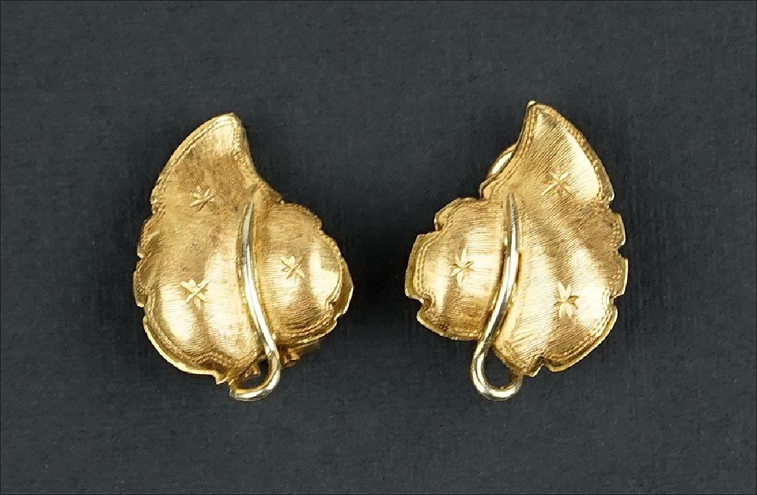 A Pair of 14 Karat Yellow Gold Earclips.