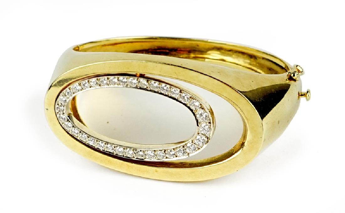 A Diamond and 14 Karat Yellow Gold Bracelet.