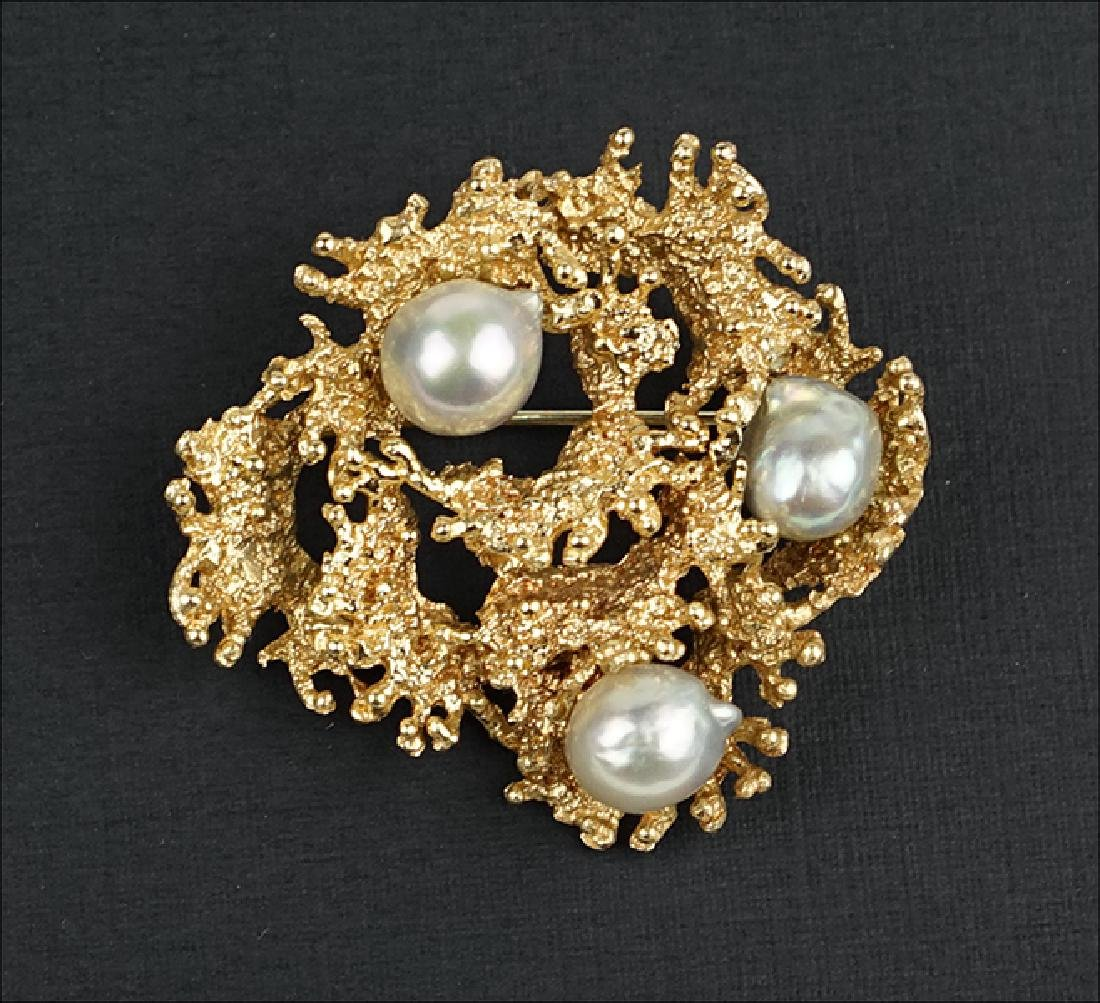 A Baroque Pearl and 14 Karat Yellow Gold Brooch.