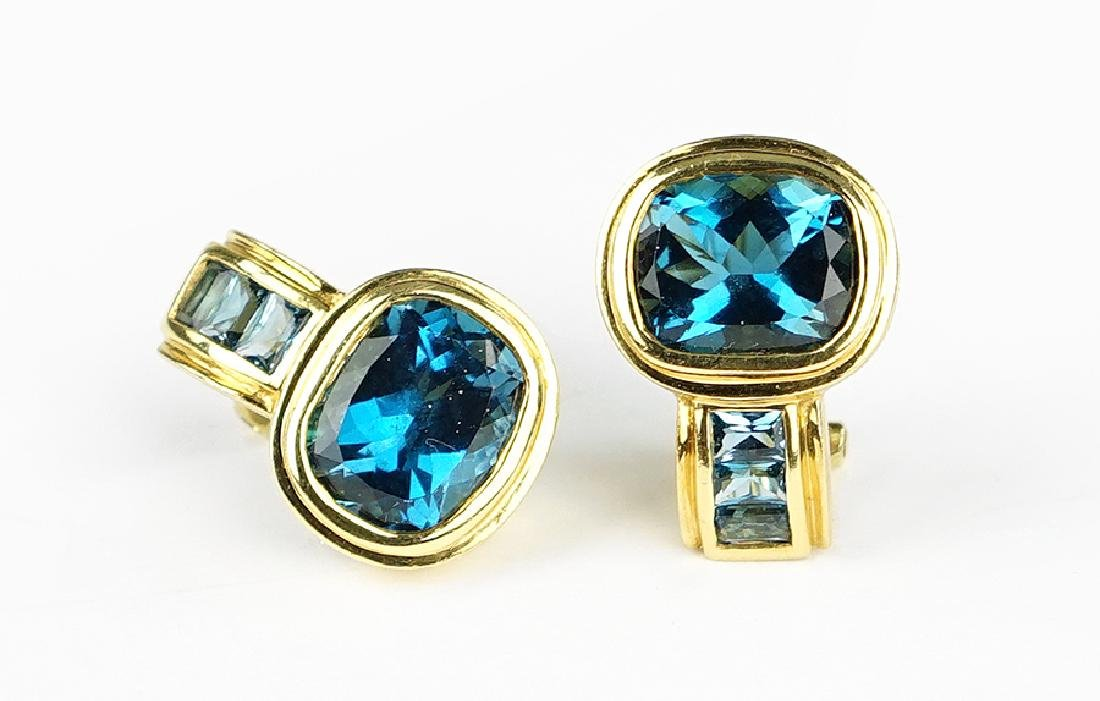 A Pair of Blue Topaz Earclips.