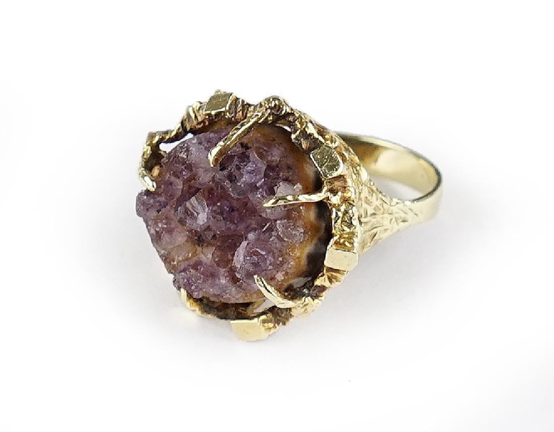 An Amethyst and 14 Karat Yellow Gold Ring.