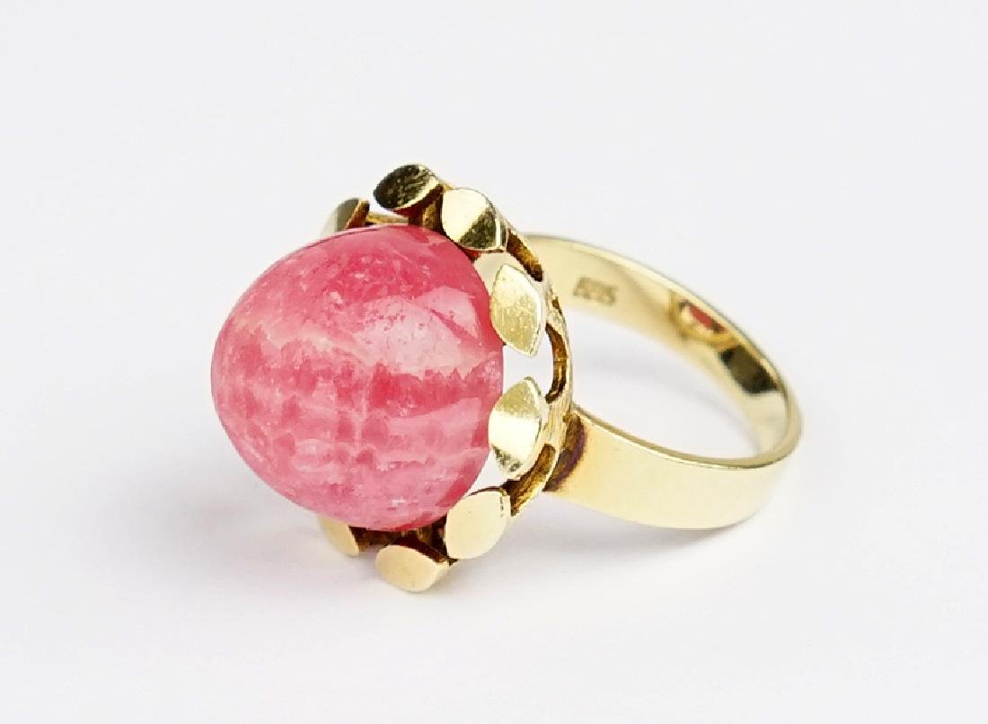A Rhodochrosite and 14 Karat Yellow Gold Ring.