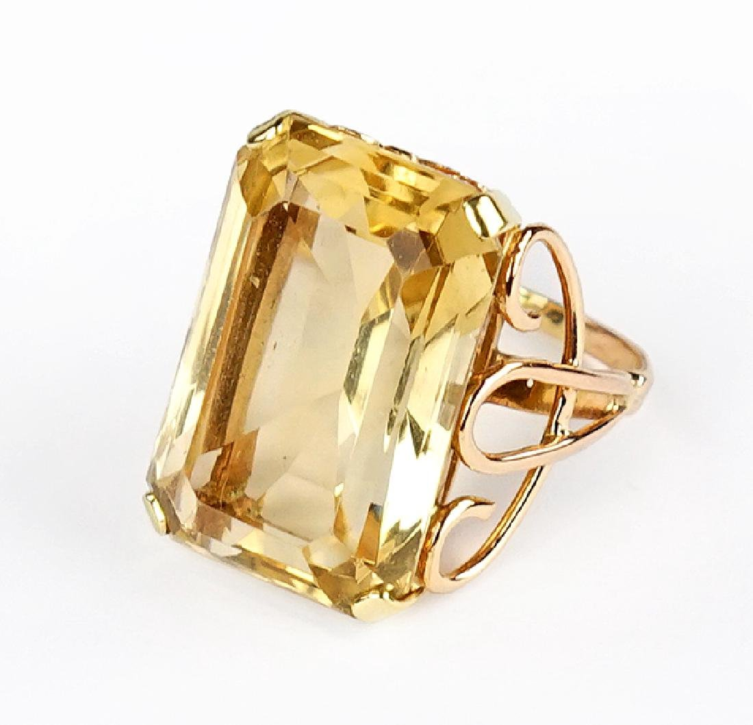 A Citrine and 14 Karat Yellow Gold Ring.