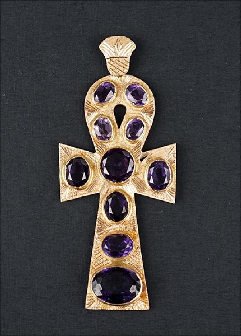 An Amethyst and 14 Karat Gold Cross Pendant.