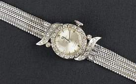 An Omega Diamond and 18 Karat White Gold Watch