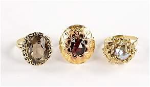 Three 14 Karat Yellow Gold Rings.