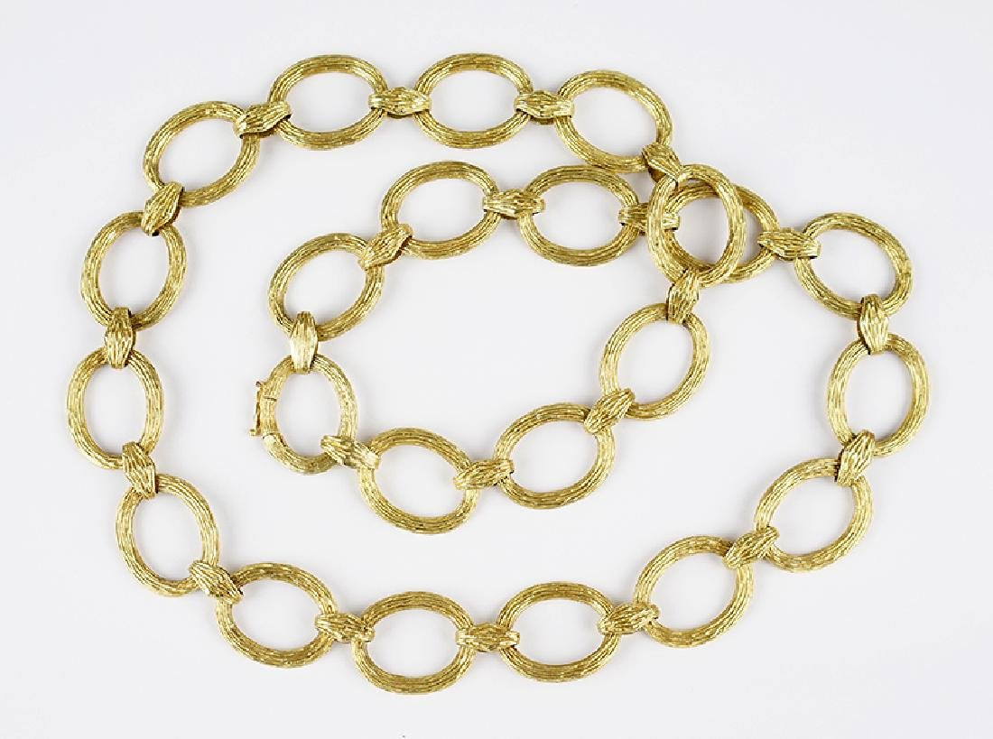 A La Triomphe 14 Karat Yellow Gold Link Necklace.