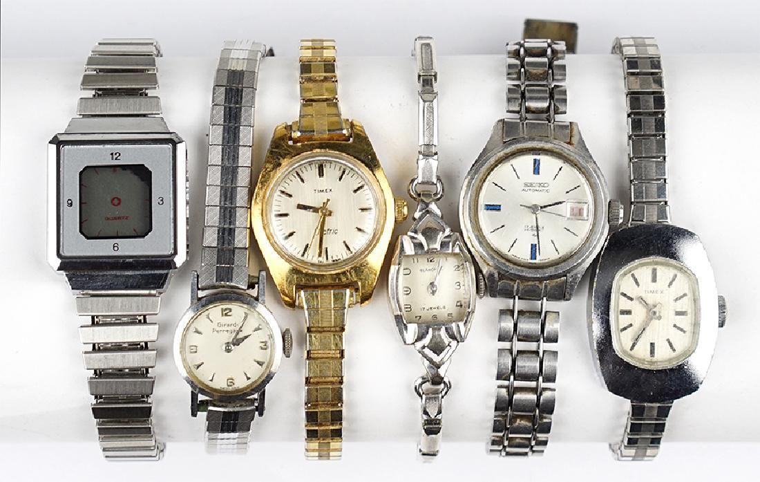 A Blancpain 14 Karat White Gold Watch.