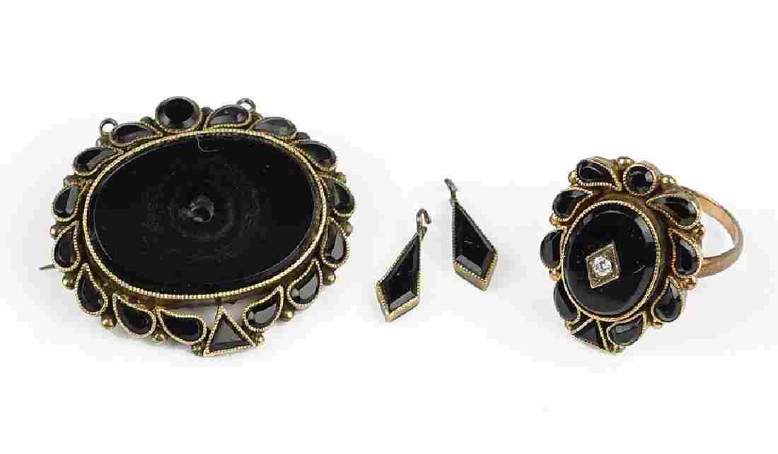 A Group Of Victorian Onyx Jewelry.