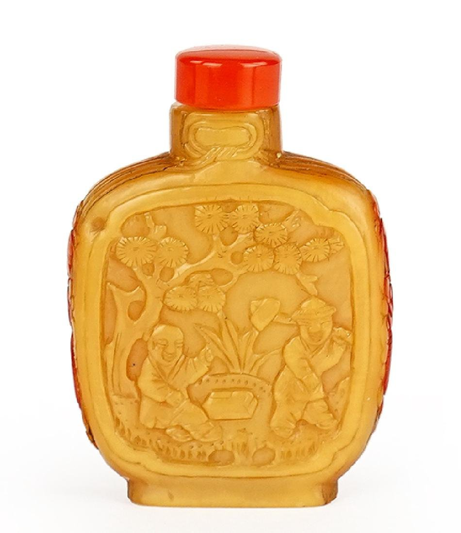 A Chinese Carved Hornbill Snuff Bottle.