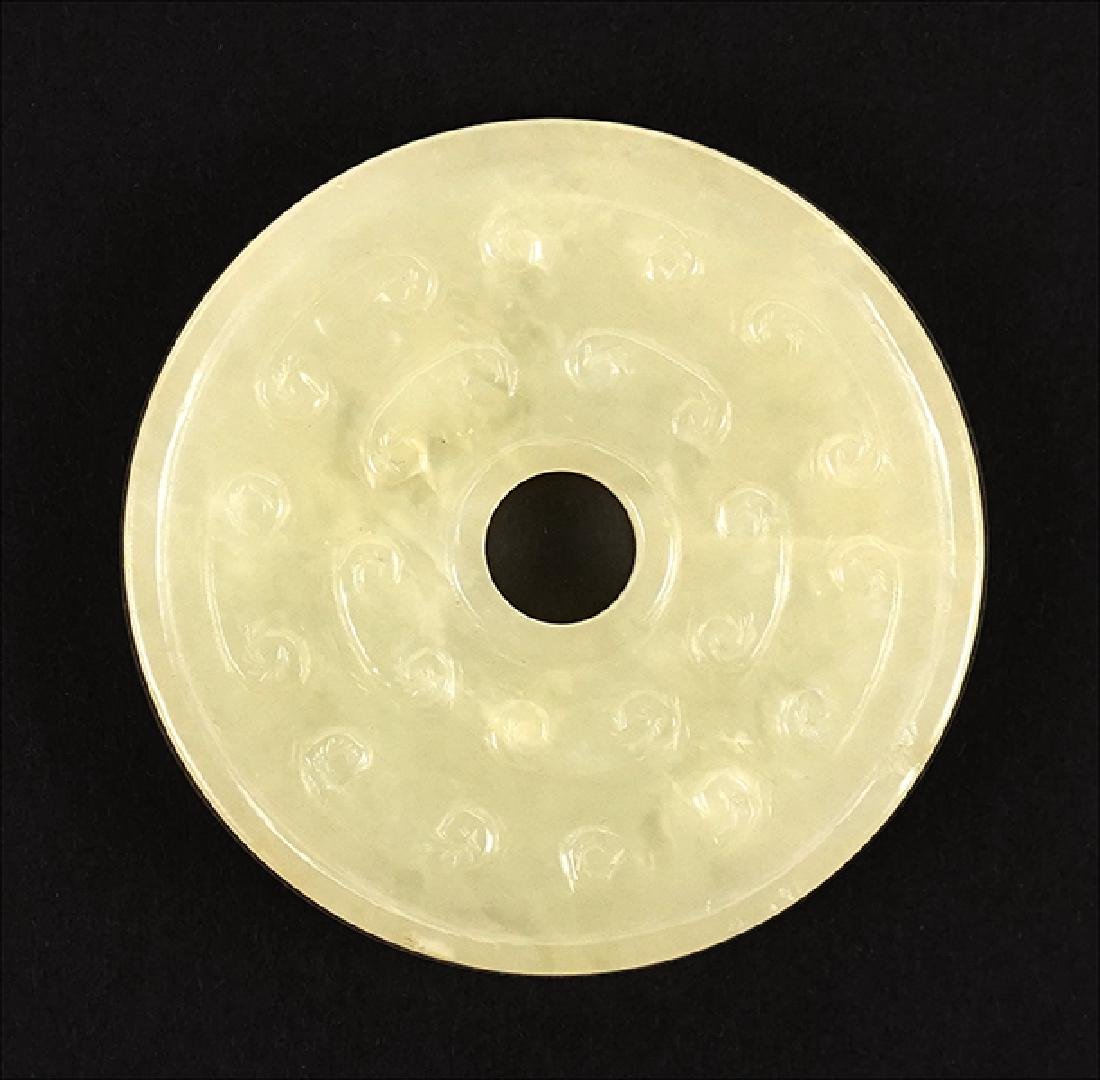 A Han Style Celadon Jade Bi-Disk.