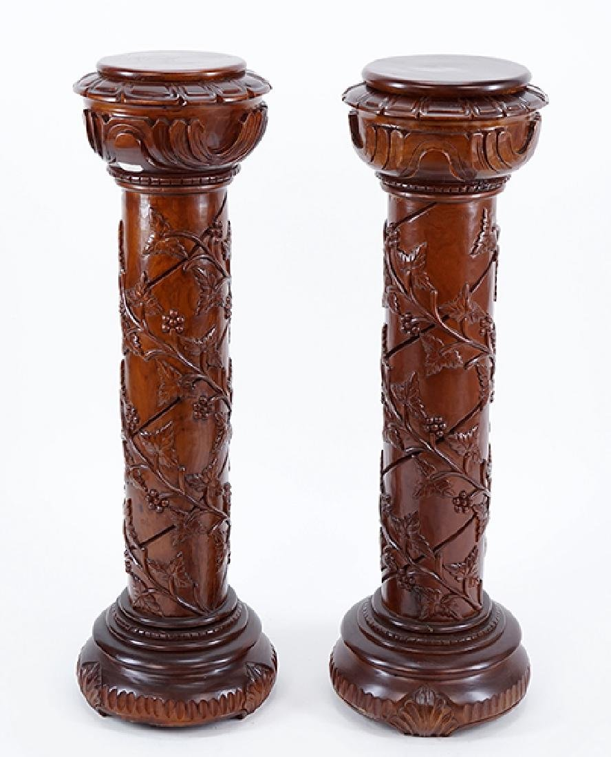 A Pair of Carved Wood Pedestals.