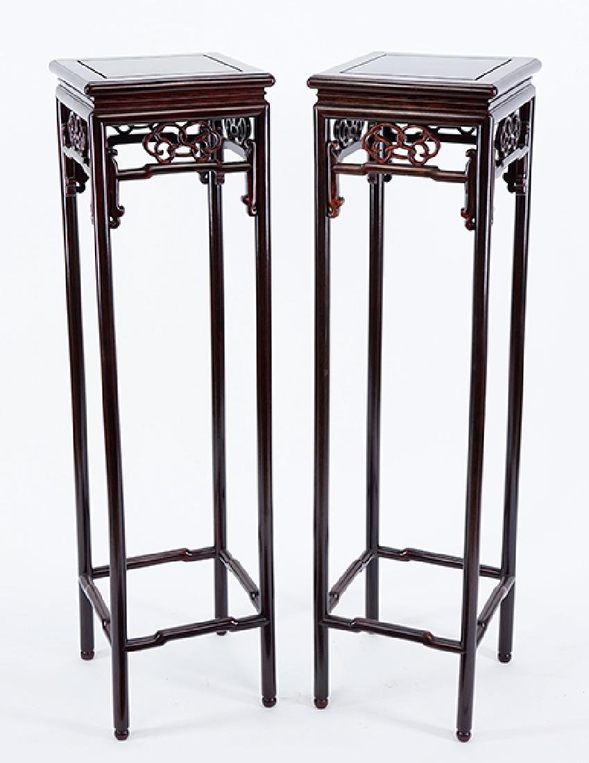 A Pair of Chinese Style Wood Pedestals.