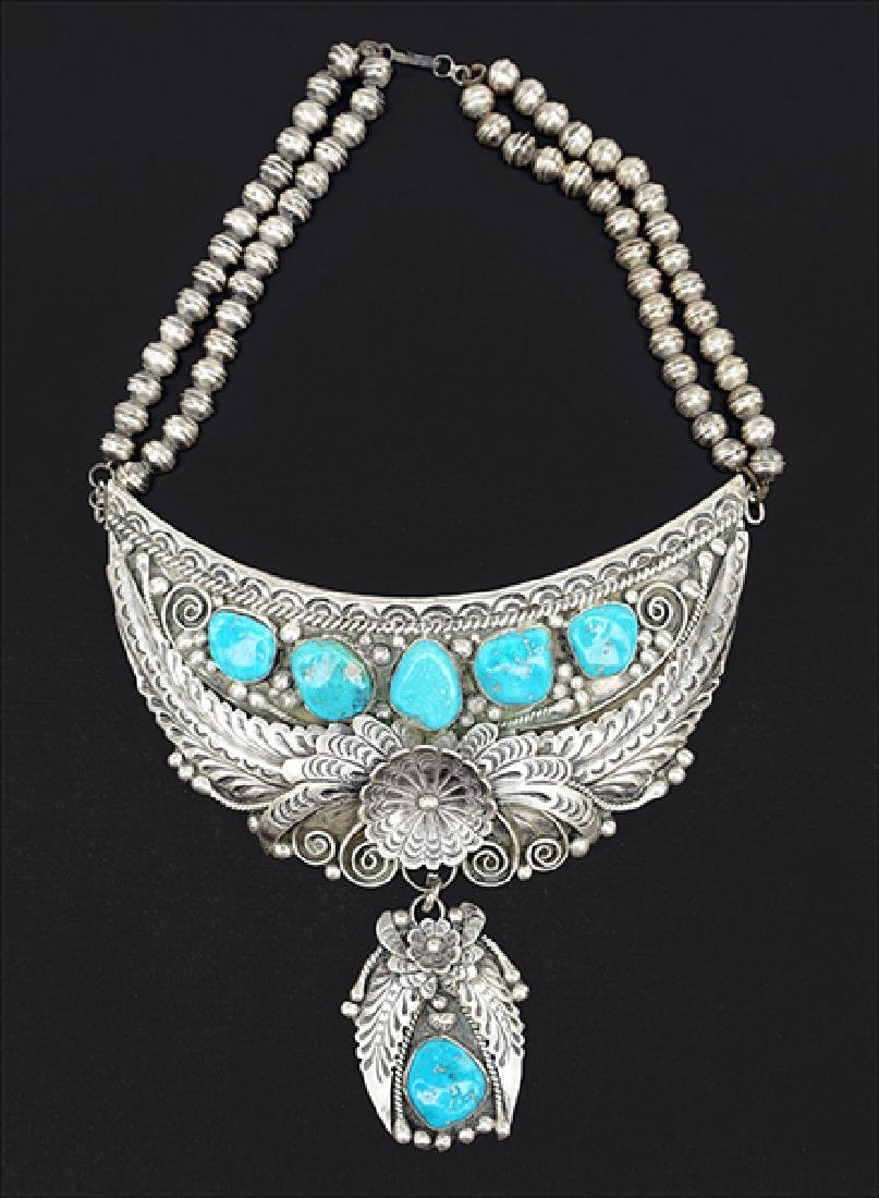 A Silver and Turquoise Necklace.