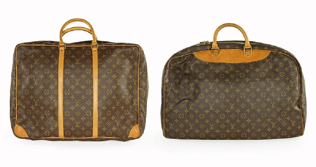 Two Louis Vuitton Suitcases.