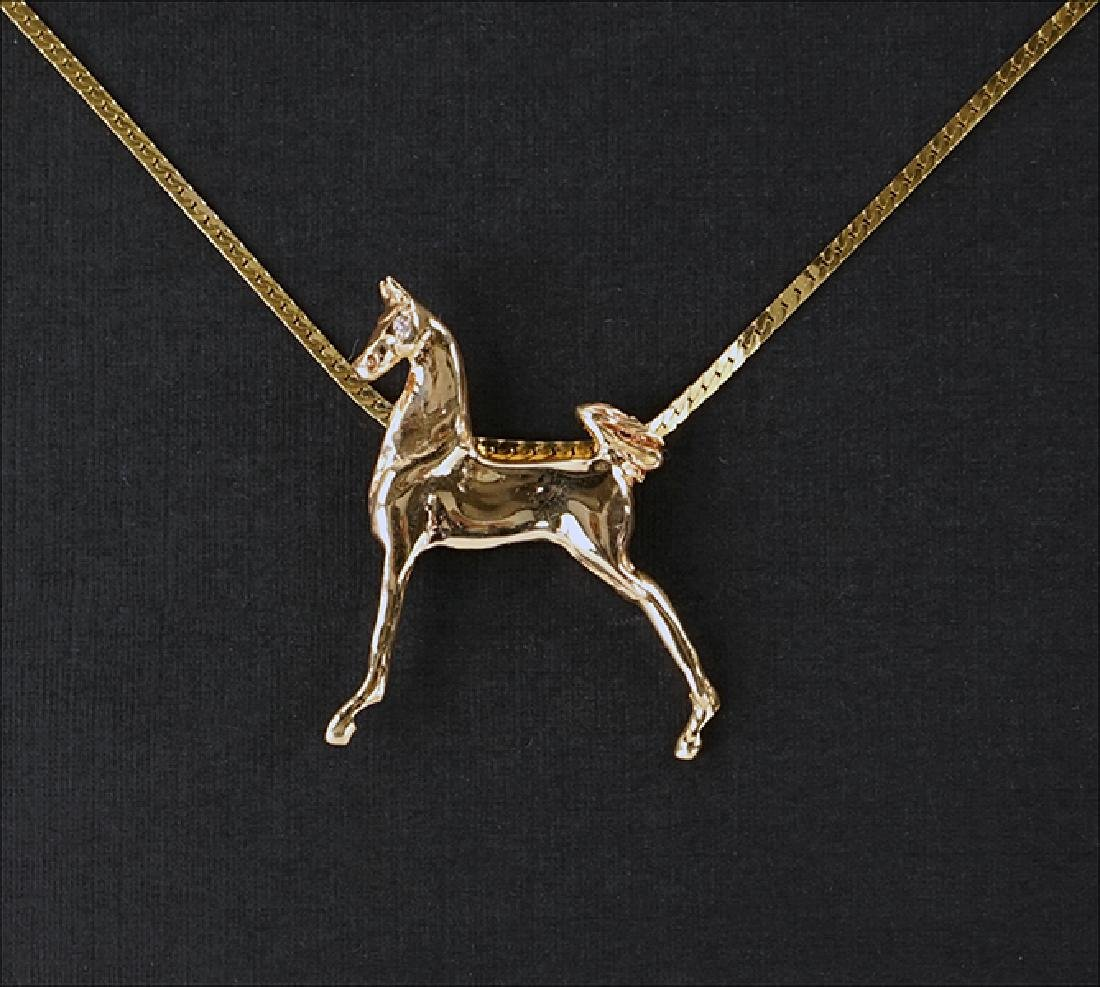 A 14 Karat Yellow Gold Horse Pendant Necklace.