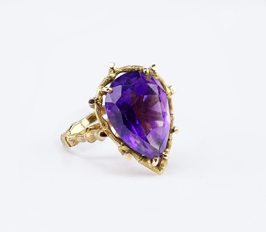 An Amethyst and 14 Karat Yellow Gold Ring.