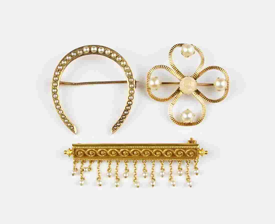 A Victorian Pearl and 10 Karat Yellow Gold Bar Brooch.