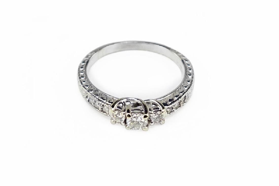A Diamond and 14 Karat White Gold Ring.