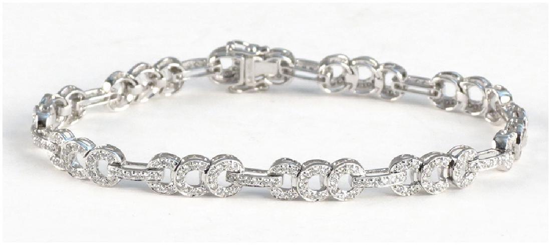 A Diamond and 14 Karat White Gold Bracelet.