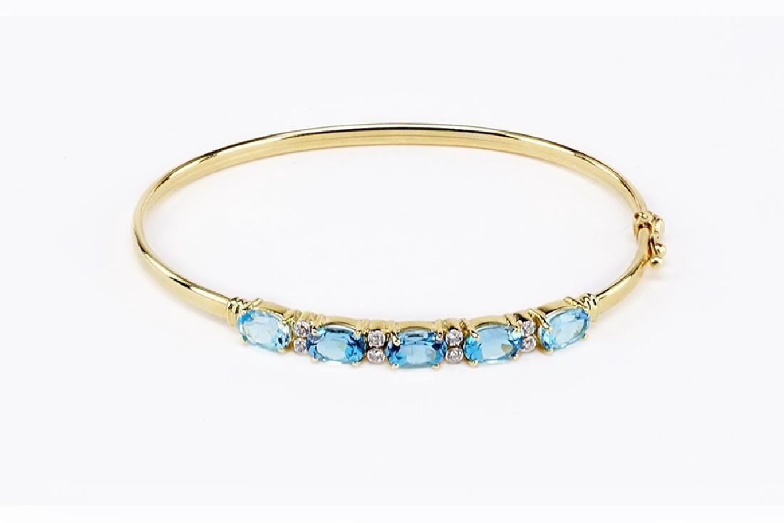 A Blue Topaz and Diamond Bangle Bracelet.