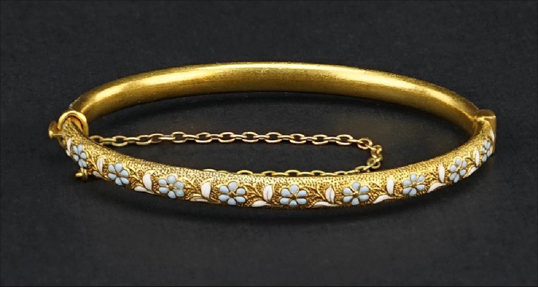 A 14 Karat Yellow Gold Bangle Bracelet.