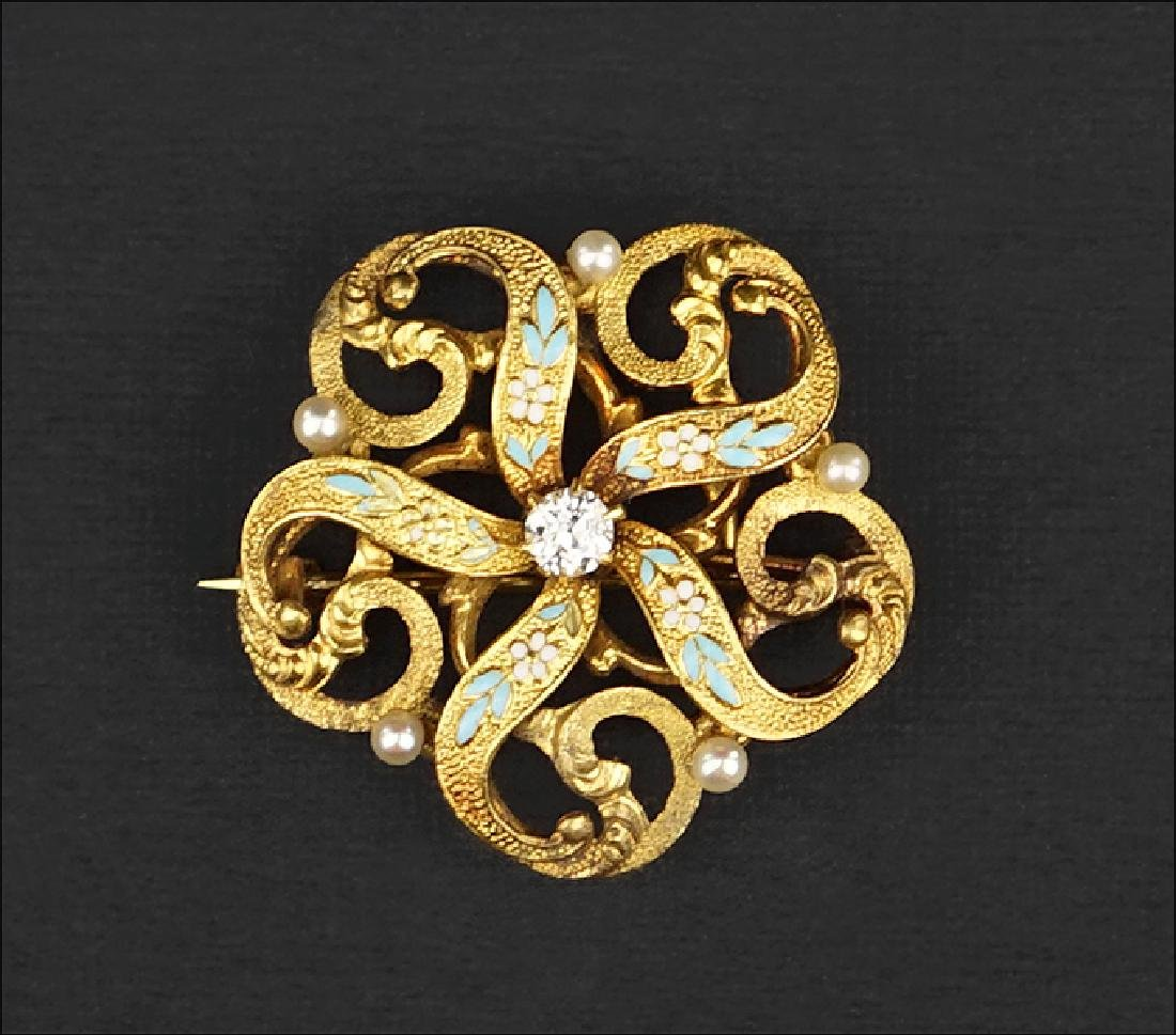 A 14 Karat Yellow Gold Brooch.