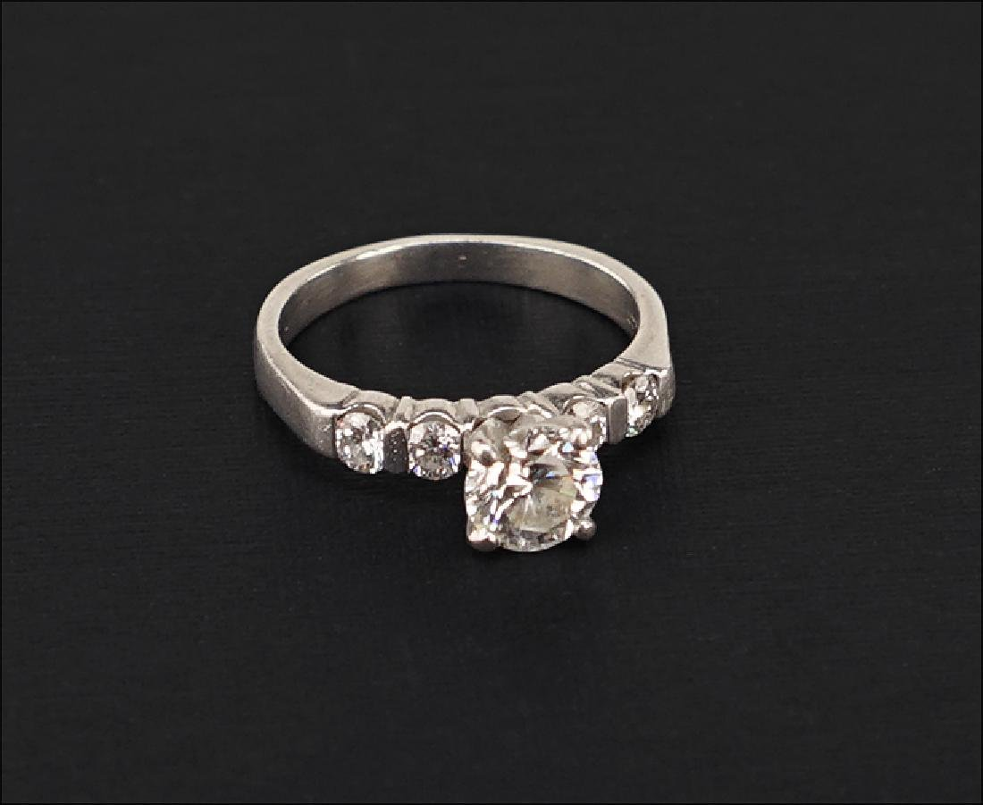 A Platinum and Diamond Engagement Ring.