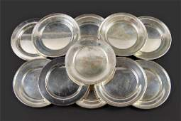 A Set of Eight Randahl Sterling Silver Plates.