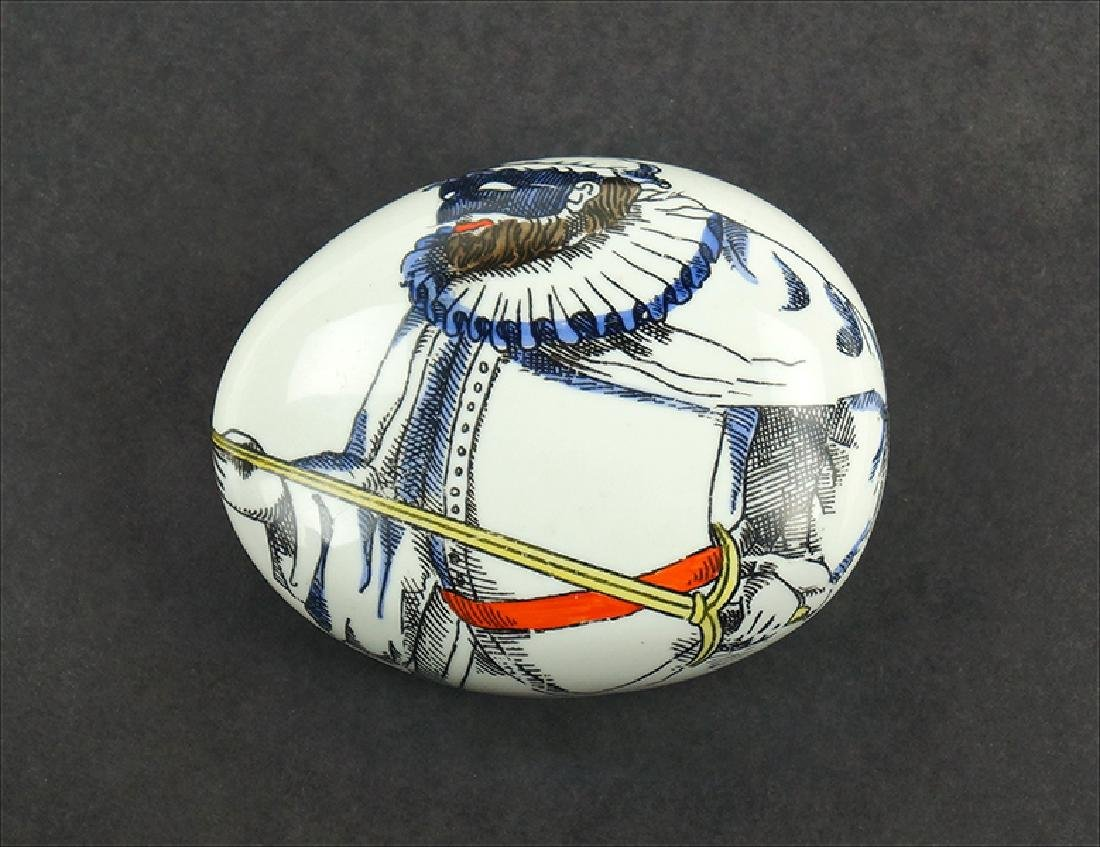 A Piero Fornasetti Paperweight.