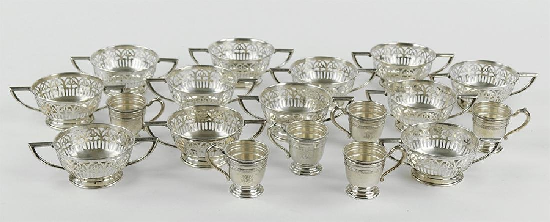 A Set of Twelve Sterling Silver Bouillon Cup Holders.
