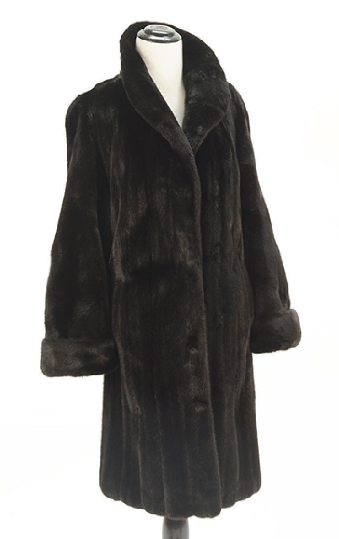 A Black Mink Swing Coat.