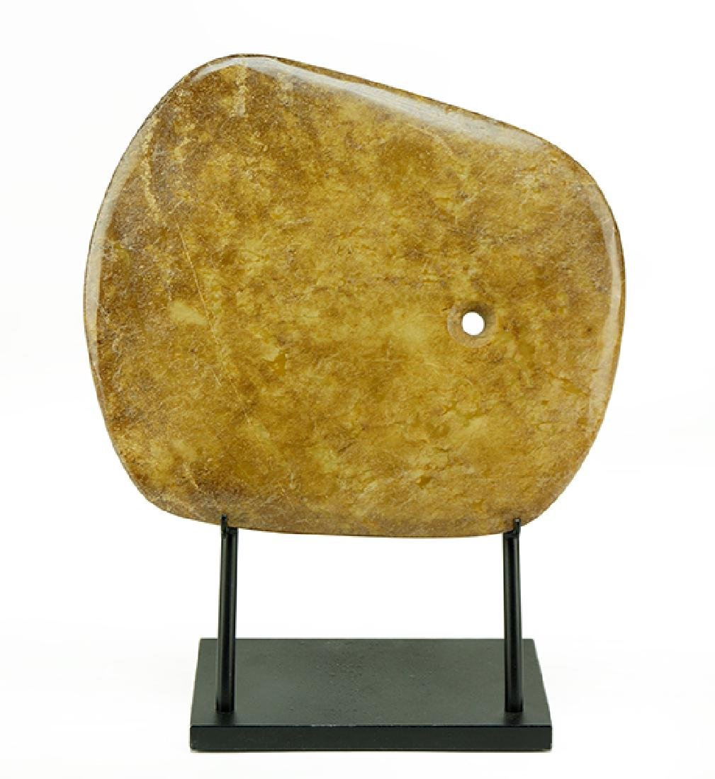 A Chinese Stone Axe Head.