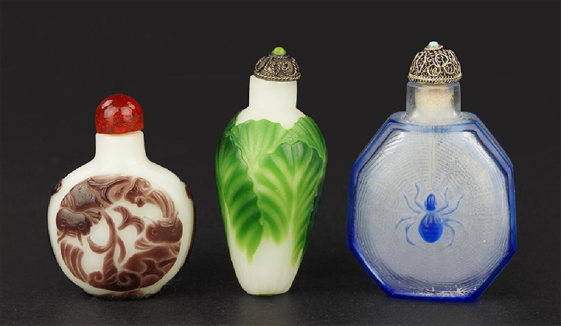 Two Peking Glass Snuff Bottles.