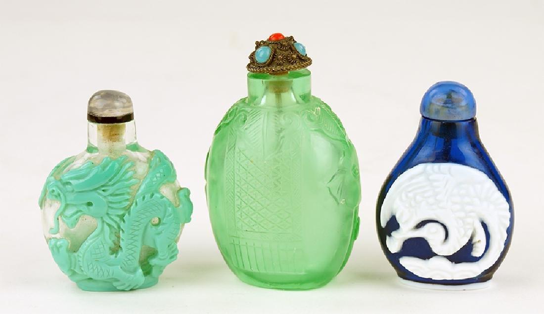 Three Glass Snuff Bottles.