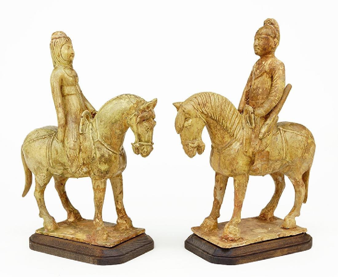 A Pair of Glazed Terra Cotta Figures on Horseback.