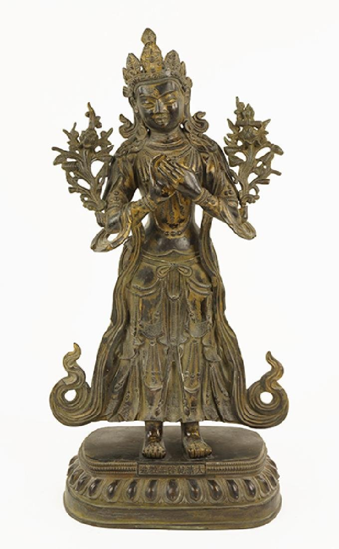 A Patinated Bronze Standing Figure of Guan Yin.