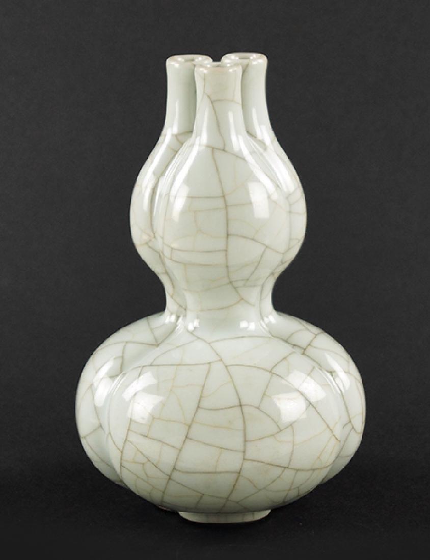 A Chinese Triple Spout Double Gourd Crackle Glaze