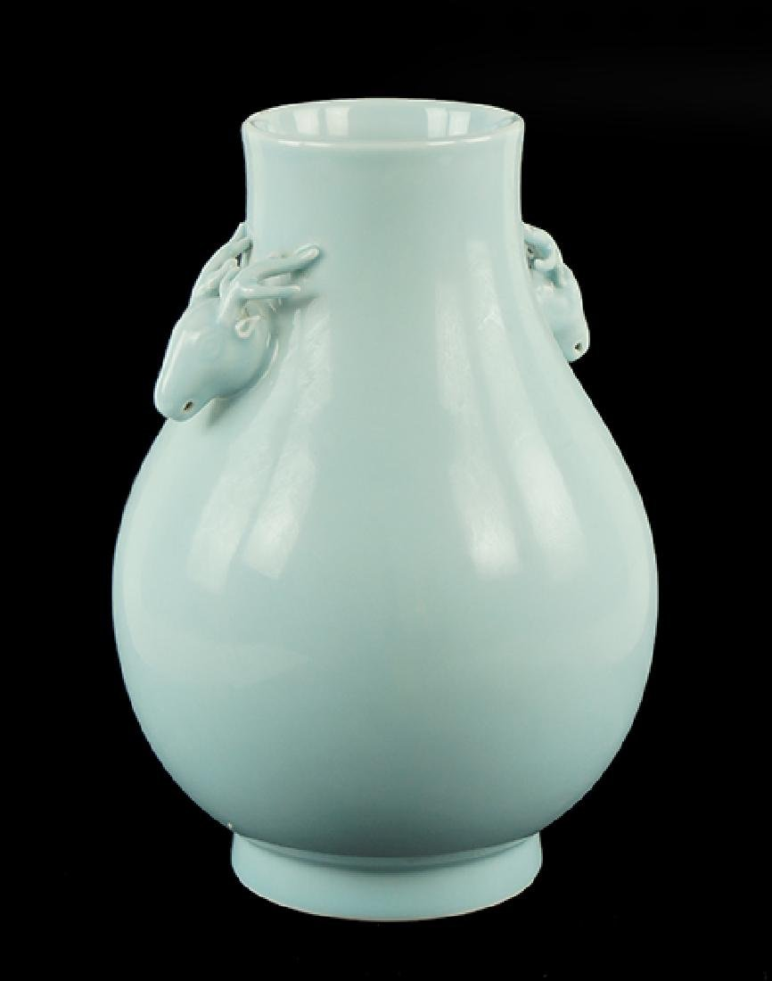 A Chinese Celadon Glazed Hu Vase.