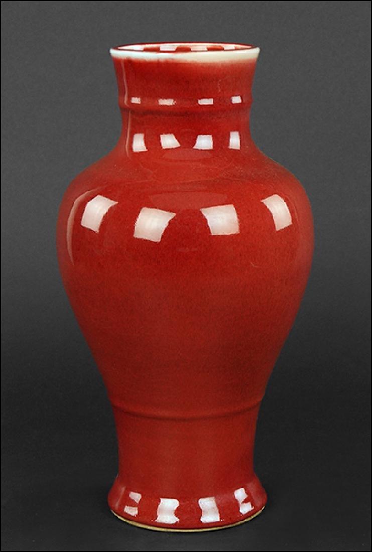 A Chinese Sang de Boeuf Glazed Baluster Vase.