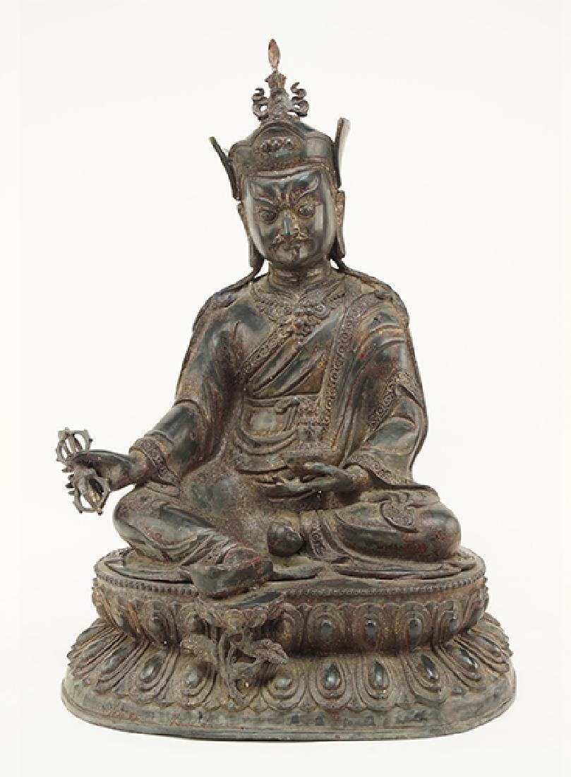 A Chinese Patinated Bronze Buddha Figure.