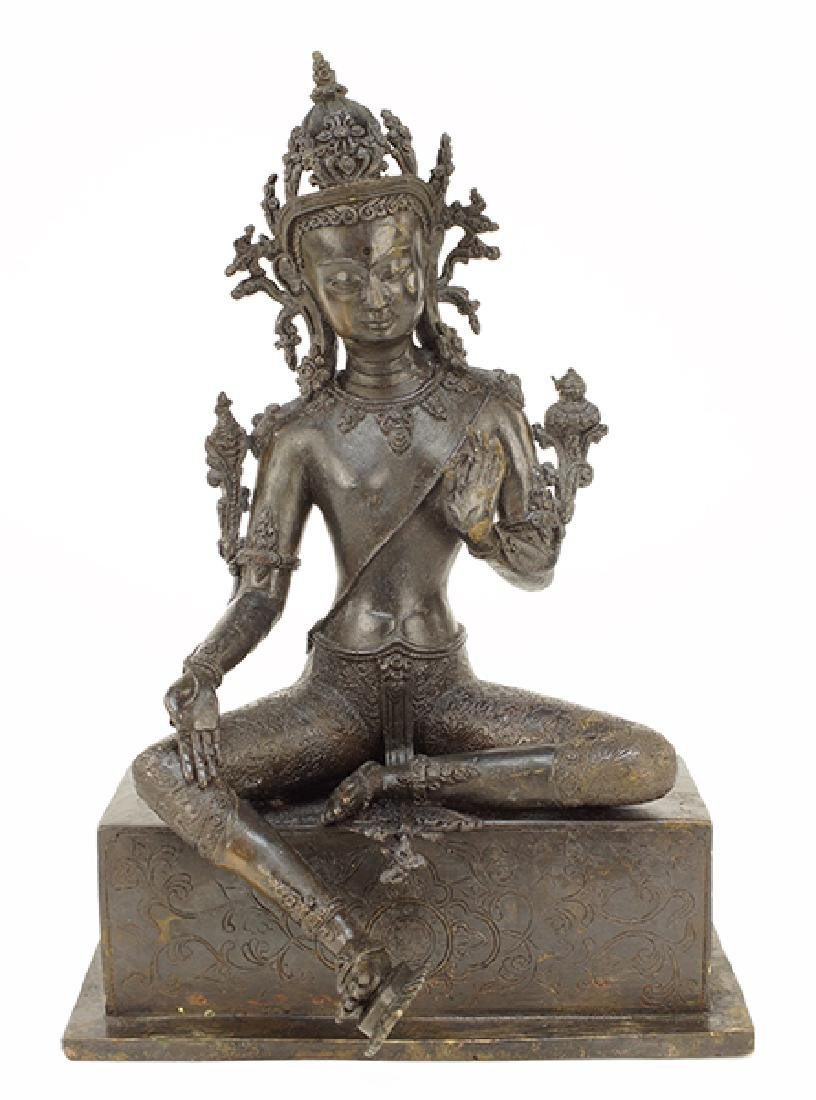 A Patinated Bronze Sino-Tibetan Seated Tara Buddha