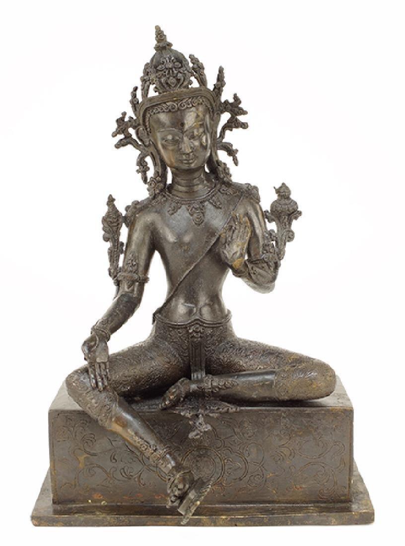 A Patinated Bronze Sino-Tibetan Seated Tara Buddha