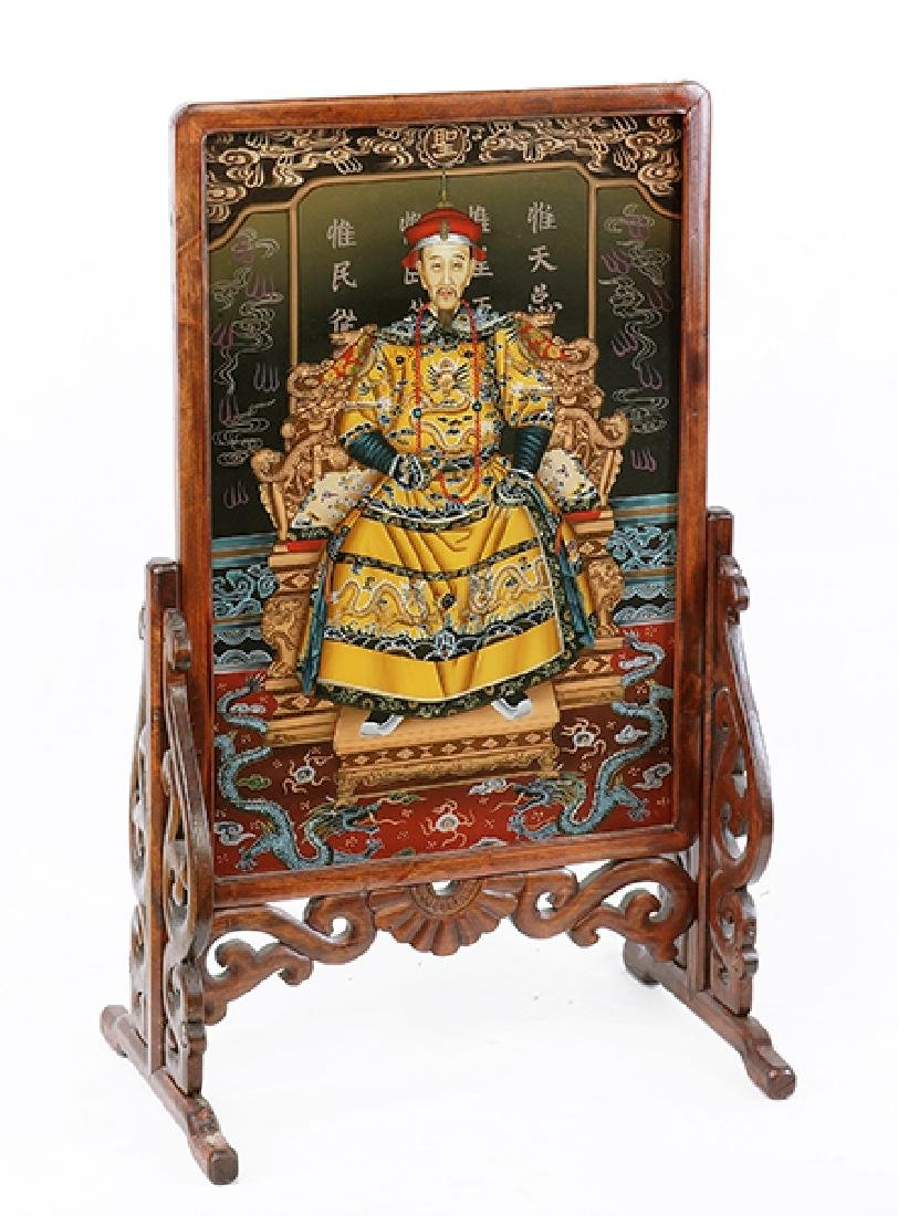 A Chinese Reverse Painted Ancestral Portrait.