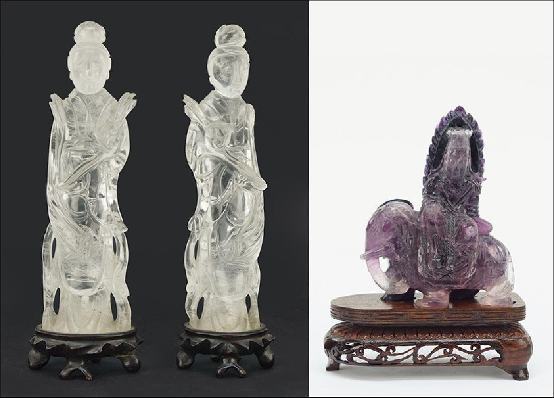A Pair of Carved Rock Crystal Figures.
