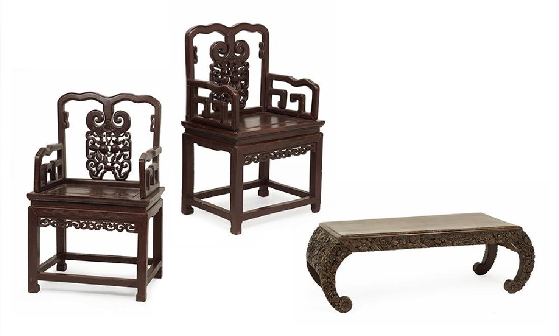 A Pair of Chinese Carved Wood Open Armchairs.