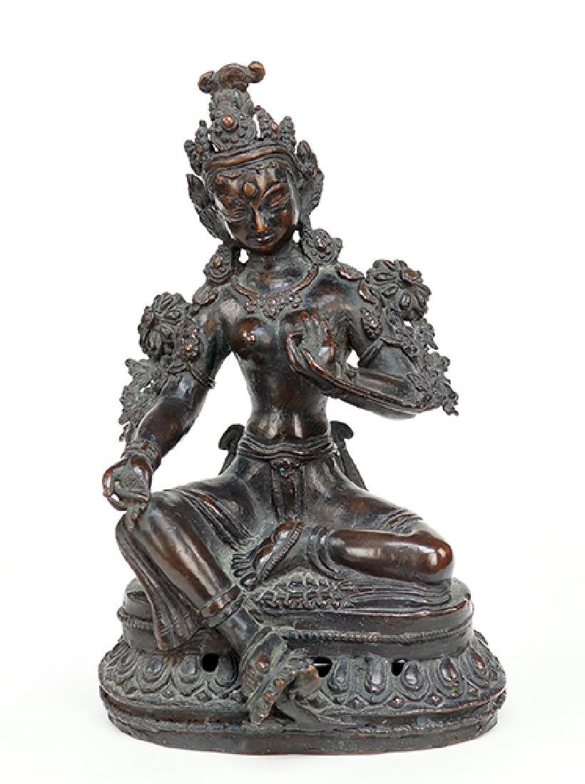 A Tibetan Patinated Bronze Figure of Tara.
